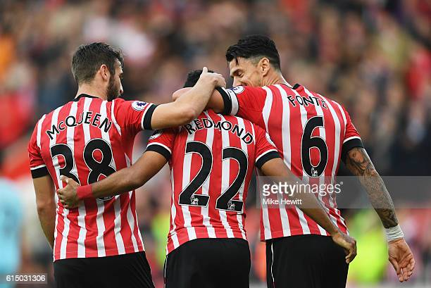 Nathan Redmond of Southampton celebrates with team mates Sam McQueen and Jose Fonte as he scores their second goal during the Premier League match...