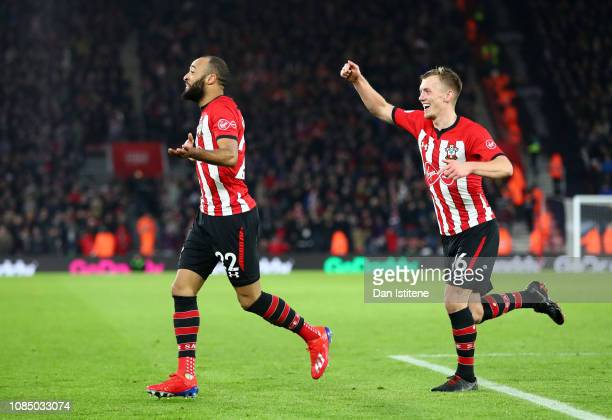 Nathan Redmond of Southampton celebrates with teammate James WardProwse after scoring his sides second goal during the Premier League match between...