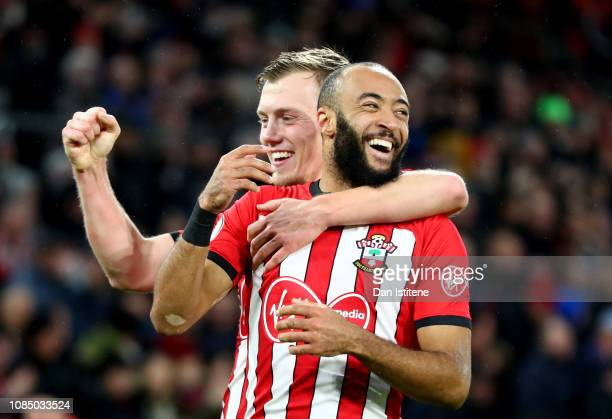 Nathan Redmond of Southampton celebrates with teammate James Ward-Prowse after his sides second goal during the Premier League match between...