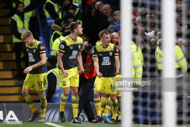 Nathan Redmond of Southampton celebrates with teammates after scoring his team's second goal during the Premier League match between Chelsea FC and...