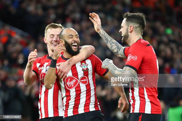 Nathan Redmond of Southampton celebrates with teammates James Ward-Prowse and Danny Ings of Southampton after his sides second goal during the...