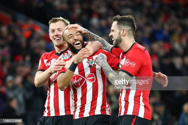 Nathan Redmond of Southampton celebrates with teammates James Ward-Prowse and Danny Ings after his sides second goal during the Premier League match...