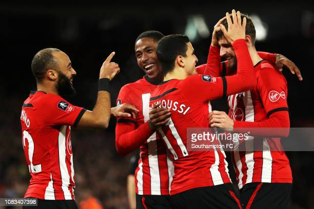 Nathan Redmond of Southampton celebrates with teammates Kayne Ramsay Mohamed Elyounoussi and Jack Stephens of Southampton after he scores his sides...