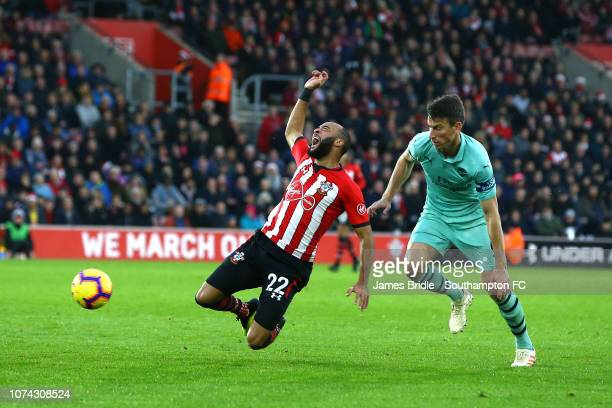 Nathan Redmond of Southampton FC goes down during the Premier League match between Southampton FC and Arsenal FC at St Mary's Stadium on December 16...
