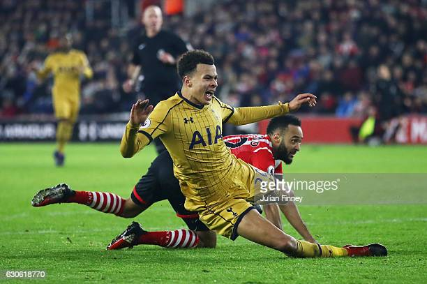 Nathan Redmond of Southampton fouls Dele Alli of Tottenham Hotspur to concede a penalty and is sent off during the Premier League match between...