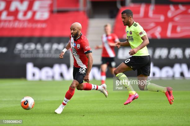 Nathan Redmond of Southampton gets away from Richairo Zivkovic of Sheffield United during the Premier League match between Southampton FC and...
