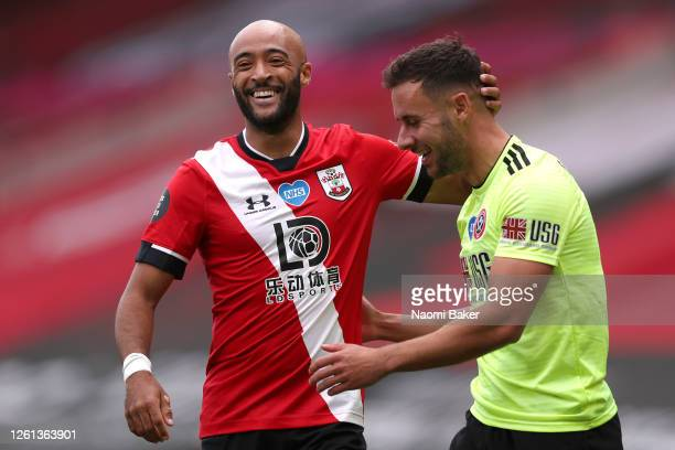 Nathan Redmond of Southampton interacts with George Baldock of Sheffield United during the Premier League match between Southampton FC and Sheffield...