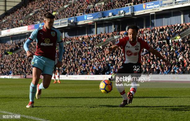 Nathan Redmond of Southampton is challenged by Matthew Lowton of Burnley during the Premier League match between Burnley and Southampton at Turf Moor...