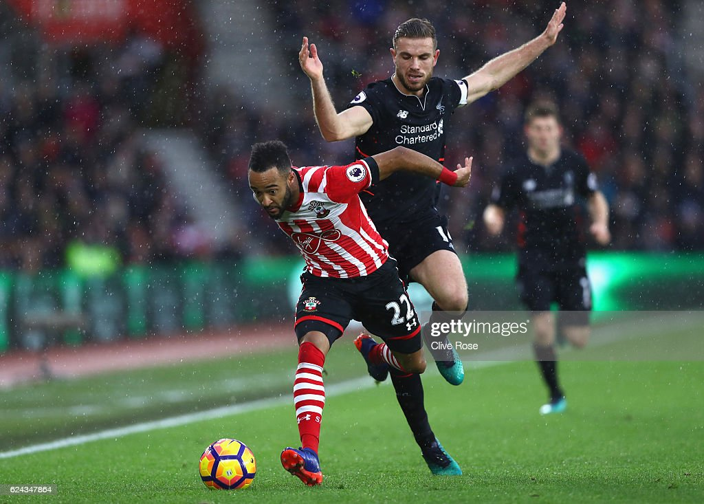 Nathan Redmond of Southampton (L) is fouled by Jordan Henderson of Liverpool (R) during the Premier League match between Southampton and Liverpool at St Mary's Stadium on November 19, 2016 in Southampton, England.