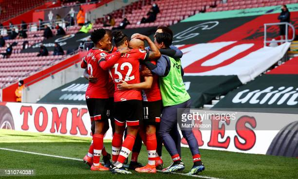 Nathan Redmond of Southampton is mobbed by his team mates after putting his team 3-2 up during the Premier League match between Southampton and...