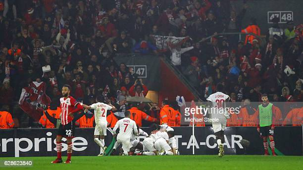 Nathan Redmond of Southampton looks dejected as Maor Buzaglo of Hapoel Be'er Sheva celebrates with team mates and fans as he scores their first goal...