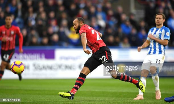 Nathan Redmond of Southampton scores his team's first goal during the Premier League match between Huddersfield Town and Southampton FC at John...