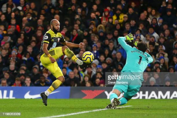 Nathan Redmond of Southampton scores his team's second goal past Kepa Arrizabalaga of Chelsea during the Premier League match between Chelsea FC and...