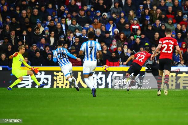 Nathan Redmond of Southampton scores the opening goal during the Premier League match between Huddersfield Town and Southampton FC at John Smith's...