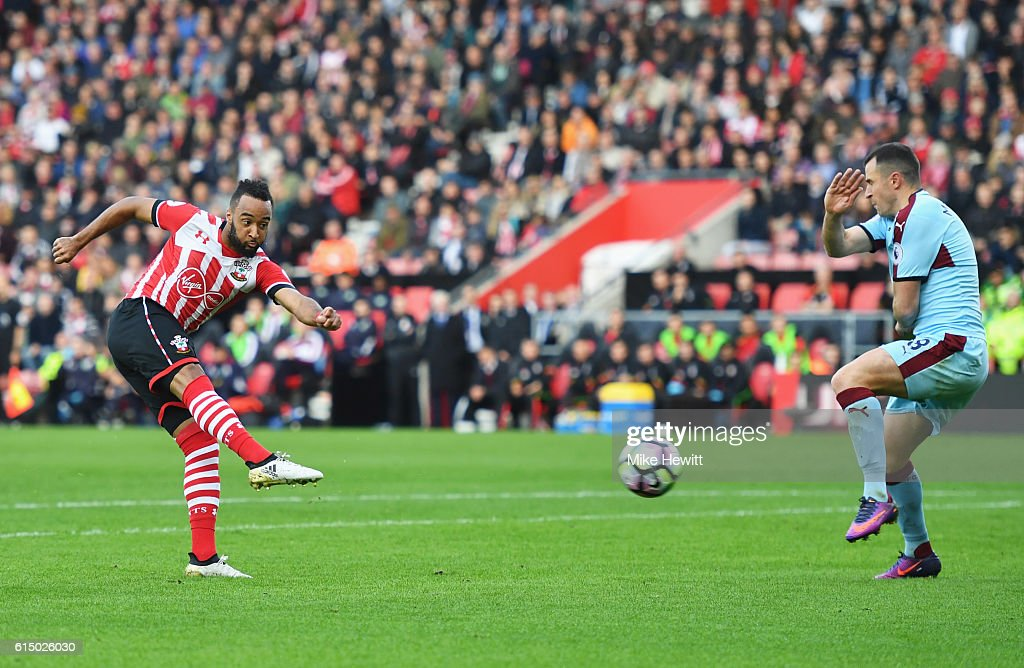 Nathan Redmond of Southampton shoots past Dean Marney of Burnley to score their second goal during the Premier League match between Southampton and Burnley at St Mary's Stadium on October 16, 2016 in Southampton, England.