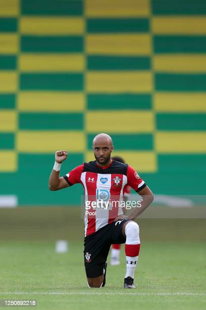 Nathan Redmond of Southampton takes a knee in support of the Black Lives Matter movement prior to the Premier League match between Norwich City and...