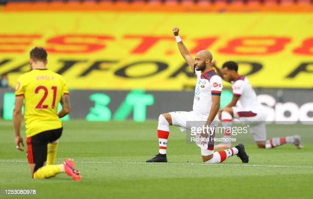 Nathan Redmond of Southampton takes a knee in support of the Black Lives Matter movement during the Premier League match between Watford FC and...