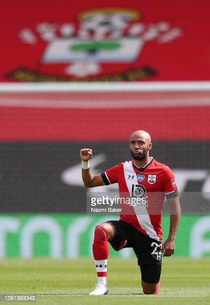 Nathan Redmond of Southampton takes a knee in support of the Black Lives Matter movement during the Premier League match between Southampton FC and...
