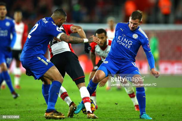 Nathan Redmond of Southampton takes on Danny Simpson and Eldin Jakupovic of Leicester City during the Premier League match between Southampton and...