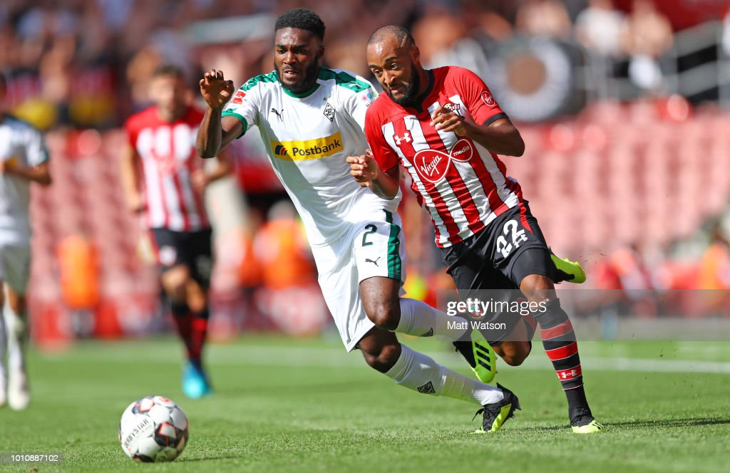 Nathan Redmond (R) of Southampton takes on Mandela Egbo of Borussia Monchengladbach during the pre-season friendly match between Southampton and Borussia Monchengladbach at St Mary's Stadium on August 4, 2018 in Southampton, England.