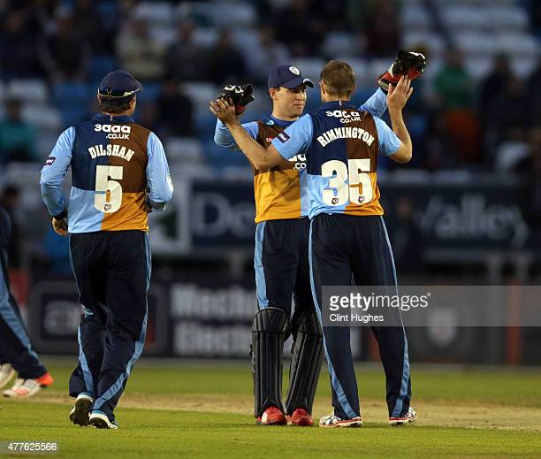 Nathan Rimmington of Derbyshire Falcons celebrates with teammate Tom Poynton after taking the wicket of Clint McKay of Leicestershire Foxes during...