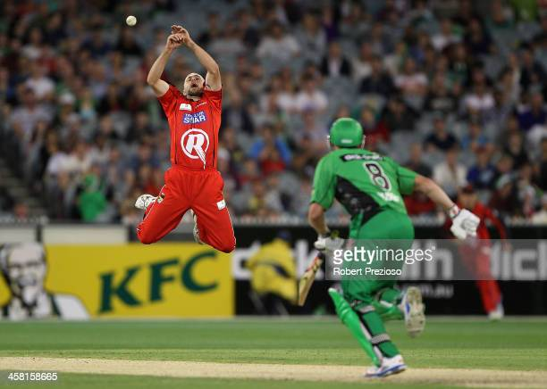 Nathan Rimmington of the Renegades attempts to take a catch off his own bowling during the Big Bash League match between the Melbourne Stars and the...