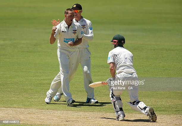 Nathan Rimmington of Western Australia celebrates the wicket of George Bailey of Tasmania during day one of the Sheffield Shield match between...