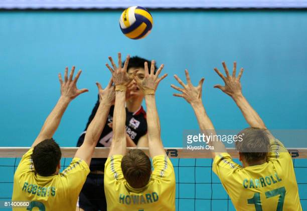 Nathan Roberts, Dainel Howard and Paul Carroll of Australia jump to block the ball against South Korea during the FIVB Men's World Olympic...