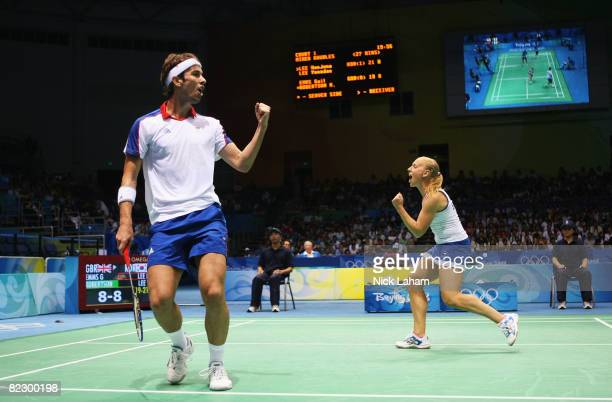 Nathan Robertson and Gail Emms of Great Britain celebrate a point as they take on Hyojung Lee and Yongdae Lee of Korea in the mixed doubles badminton...