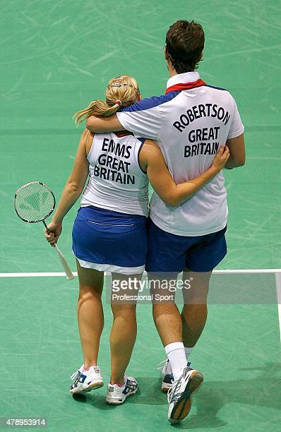 Nathan Robertson and Gail Emms of Great Britain console each other after being defeated by Hyojung Lee and Yongdae Lee of Korea in the Mixed Doubles...