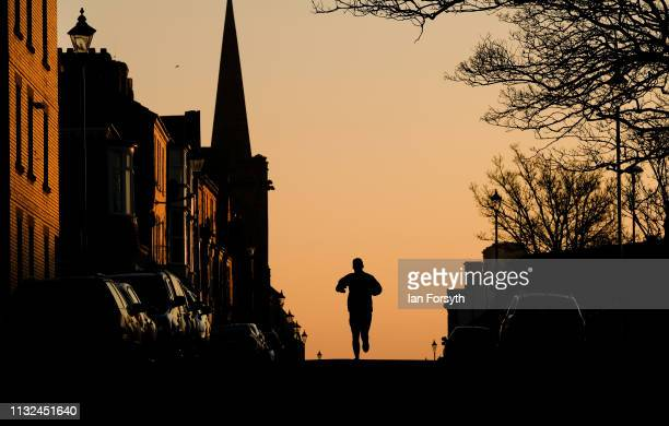 Nathan Robinson from Saltburn goes for a morning run through the town at sunrise on February 27 2019 in Saltburn By The Sea England Another day of...