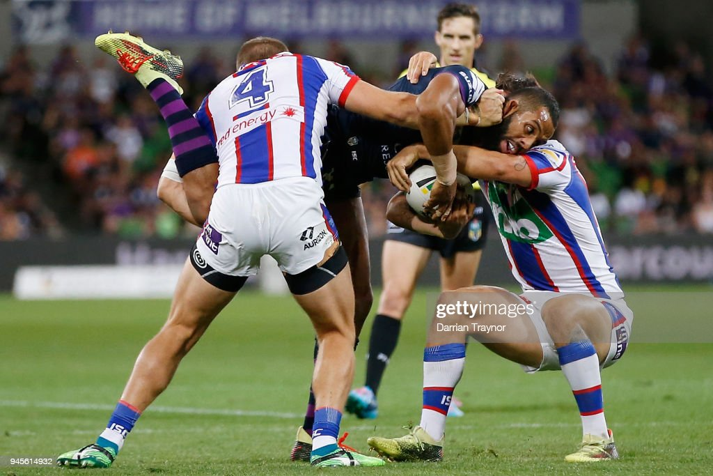 Nathan Ross and Mitchell Pearce of the Knights tackle Josh Addo-Carr of the Storm during the round six NRL match between the Melbourne Storm and the Newcastle Knights at AAMI Park on April 13, 2018 in Melbourne, Australia.