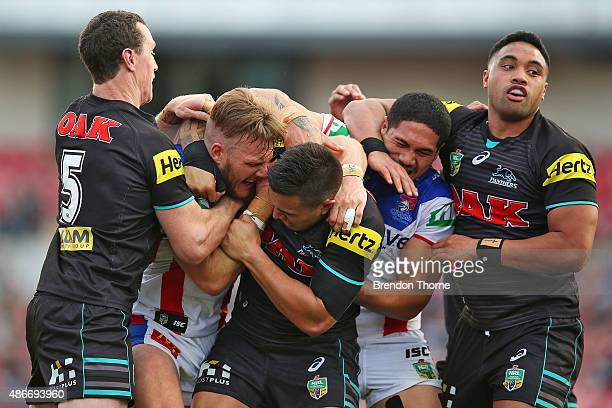 Nathan Ross of the Knights and Dean Whare of the Panthers fight during the round 26 NRL match between the Penrith Panthers and the Newcastle Knights...