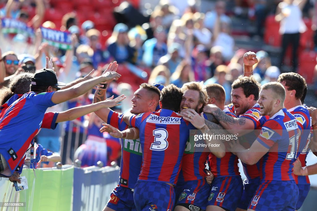 Nathan Ross of the Knights celebrates his try with team mates during the round two NRL match between the Newcastle Knights and the Gold Coast Titans at McDonald Jones Stadium on March 11, 2017 in Newcastle, Australia.