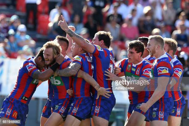Nathan Ross of the Knights celebrates his try with team mates during the round two NRL match between the Newcastle Knights and the Gold Coast Titans...