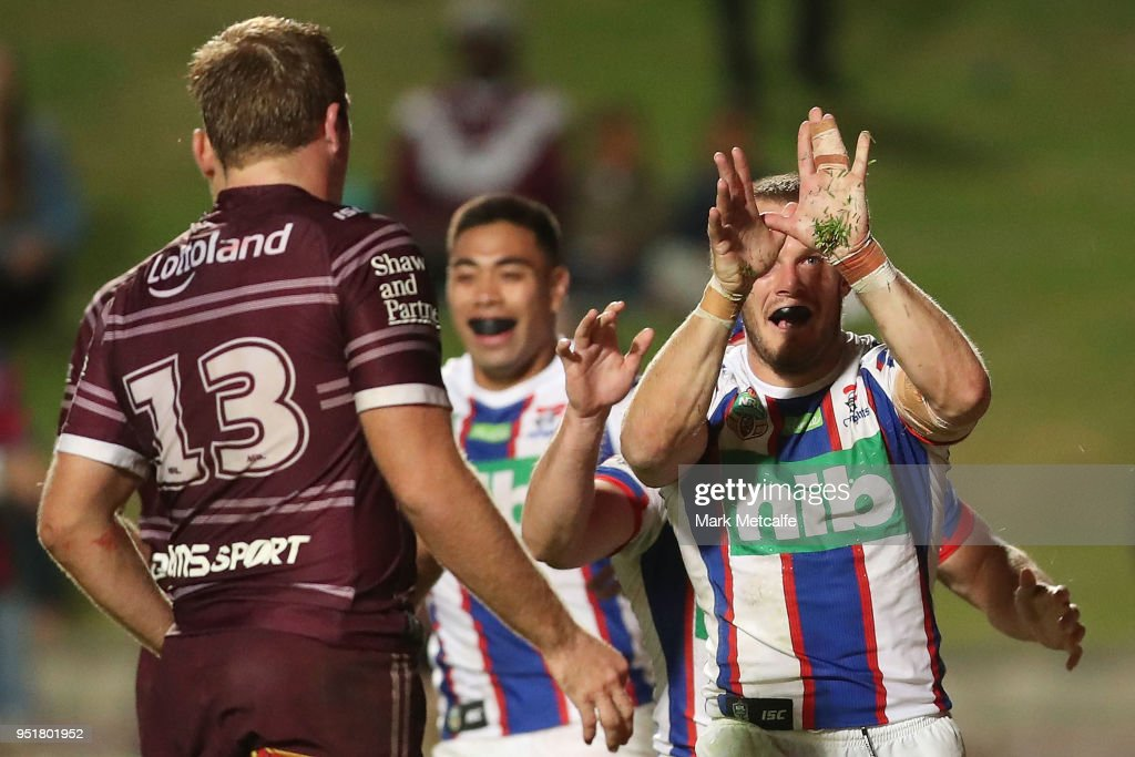 Nathan Ross of the Knights celebrates scoring a try during the Round eight NRL match between the Manly-Warringah Sea Eagles and the Newcastle Knights at Lottoland on April 27, 2018 in Sydney, Australia.