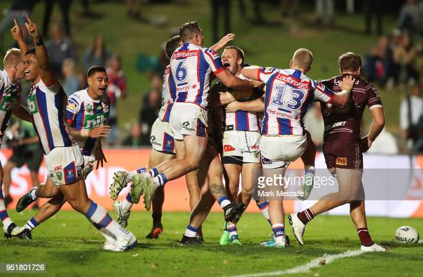 Nathan Ross of the Knights celebrates scoring a try with team mates during the Round eight NRL match between the ManlyWarringah Sea Eagles and the...