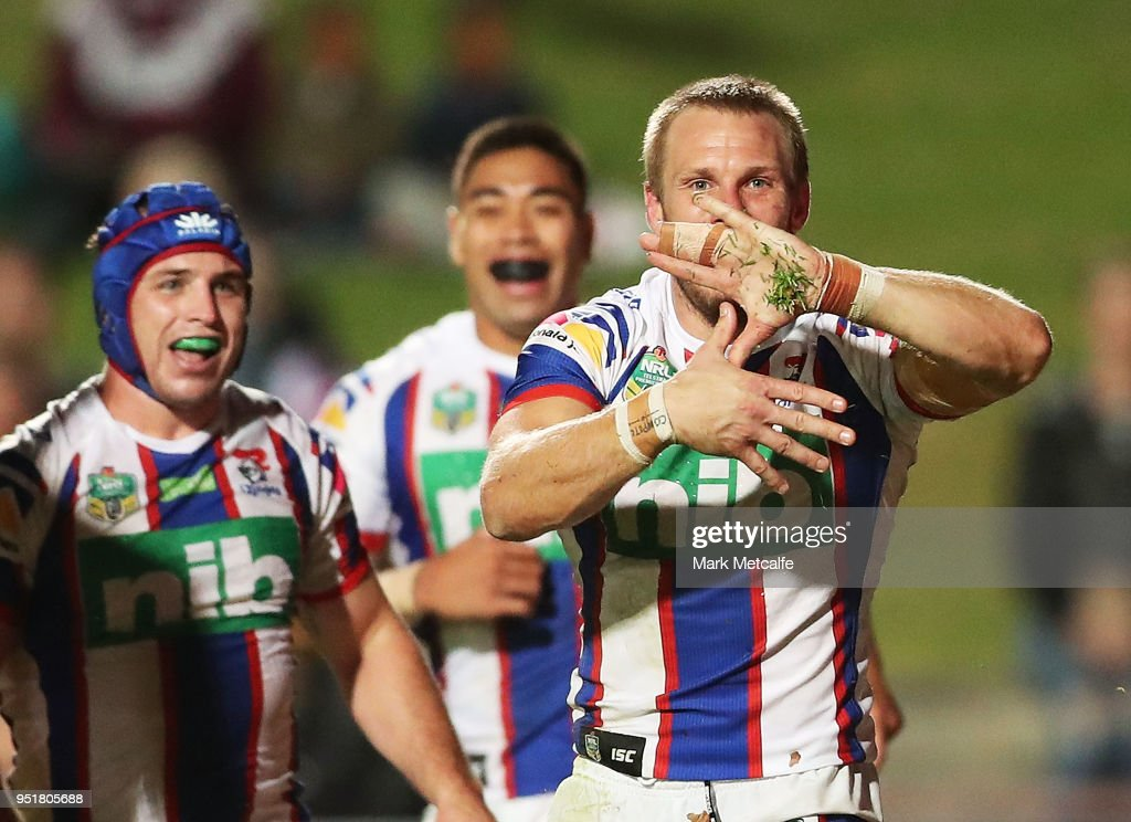 Nathan Ross of the Knights celebrates scoring a try with team mates during the Round eight NRL match between the Manly-Warringah Sea Eagles and the Newcastle Knights at Lottoland on April 27, 2018 in Sydney, Australia.