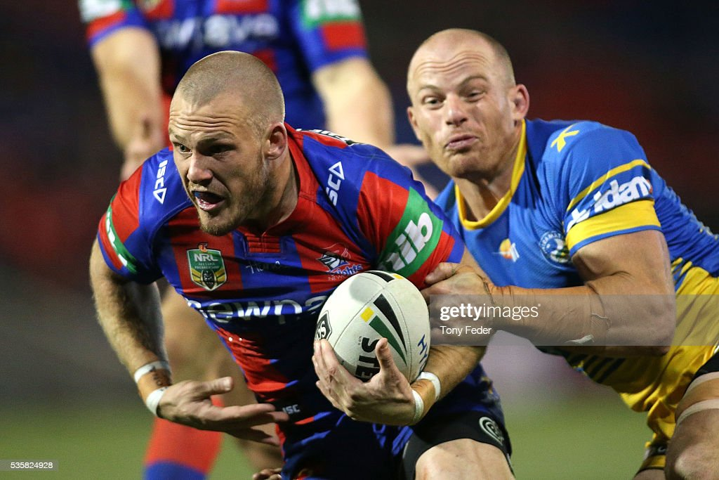 Nathan Ross of the Knights is tackled by Beau Scott of the Eels during the round 12 NRL match between the Newcastle Knights and the Parramatta Eels at Hunter Stadium on May 30, 2016 in Newcastle, Australia.