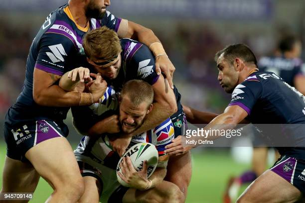Nathan Ross of the Knights is tackled by the Storm defence during the round six NRL match between the Melbourne Storm and the Newcastle Knights at...