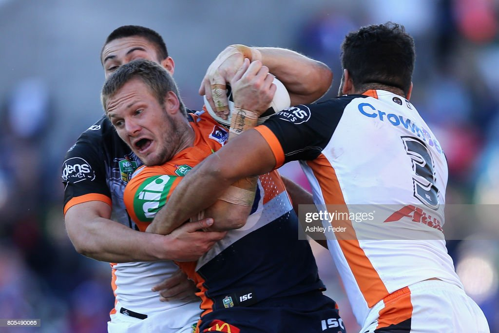 Nathan Ross of the Knights is tackled by the Tigers defence during the round 17 NRL match between the Newcastle Knights and the Wests TIgers at McDonald Jones Stadium on July 2, 2017 in Newcastle, Australia.