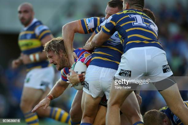 Nathan Ross of the Knights is tackled during the NRL Trial Match between the Newcastle Knights and the Parramatta Eels at Maitland No 1 Showground on...