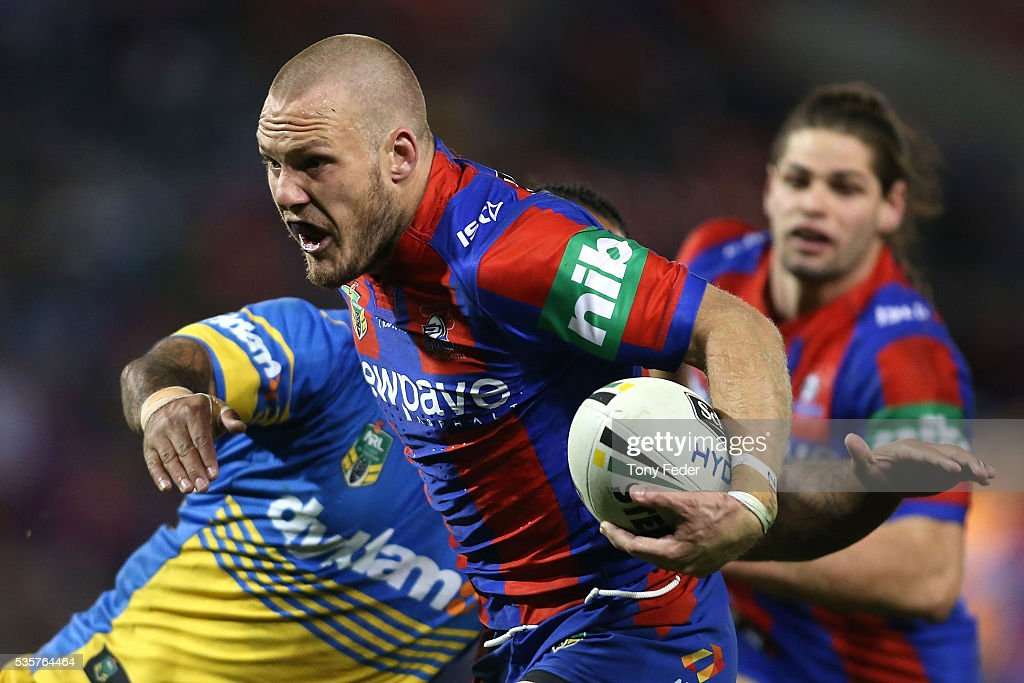Nathan Ross of the Knights is tackled during the round 12 NRL match between the Newcastle Knights and the Parramatta Eels at Hunter Stadium on May 30, 2016 in Newcastle, Australia.