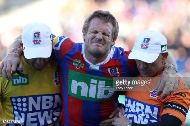Nathan Ross of the Knights is taken from the ground after getting injured during the round 22 NRL match between the Newcastle Knights and the New...