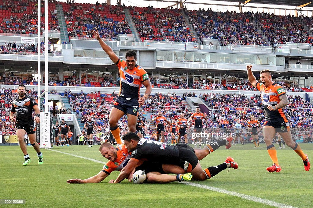 Nathan Ross of the Knights scores a try during the round six NRL match between the Newcastle Knights and the Wests Tigers at Hunter Stadium on April 10, 2016 in Newcastle, Australia.