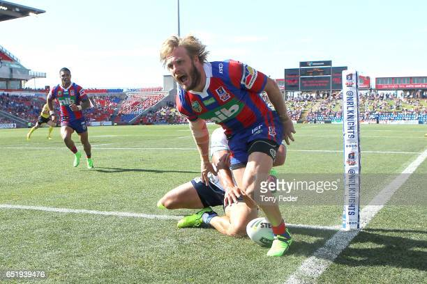 Nathan Ross of the Knights scores a try during the round two NRL match between the Newcastle Knights and the Gold Coast Titans at McDonald Jones...