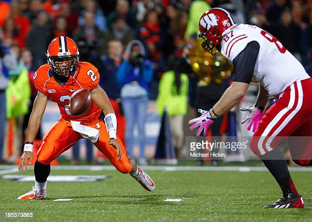 f28d86c0a Nathan Scheelhaase of the Illinois Fighting Illini fumbles the football as Ethan  Hemer of the Wisconsin