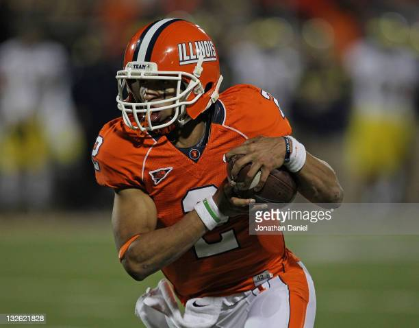 Nathan Scheelhaase of the Illinois Fighting Illini runs for a touchown against the Michigan Wolverines at Memorial Stadium on November 12, 2011 in...
