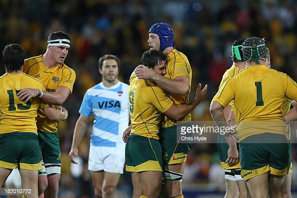 Nathan Sharpe and Nick Phipps of the Australian Wallabies celebrate winning the Rugby Championship match between the Australian Wallabies and...