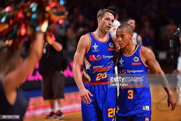 Nathan Sobey and Jerome Randle of the Adelaide 36ers walk off the court after the round 15 NBL match between the Adelaide 36ers and Melbourne United...